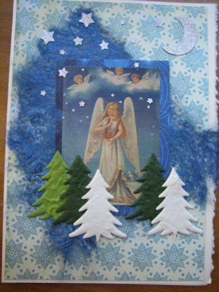 angel with lyre in sky with evergreens