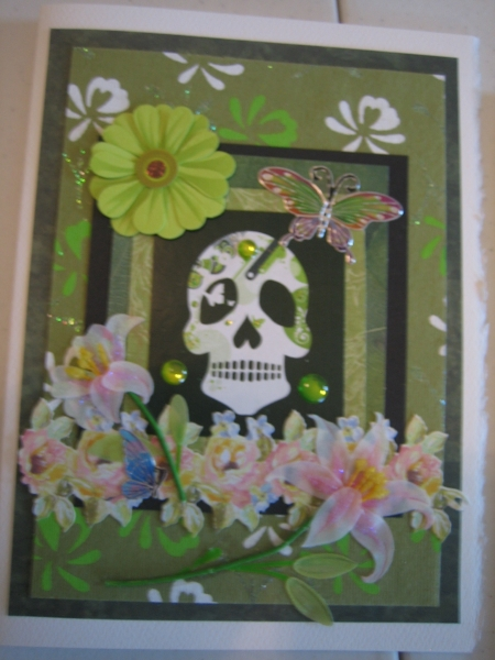 Green skull with lilies