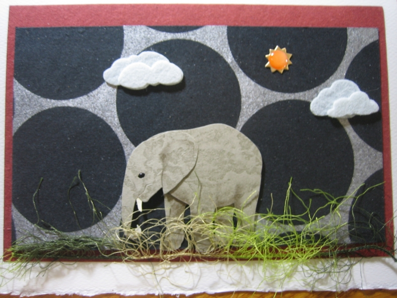 Young elephant with black circles, sun