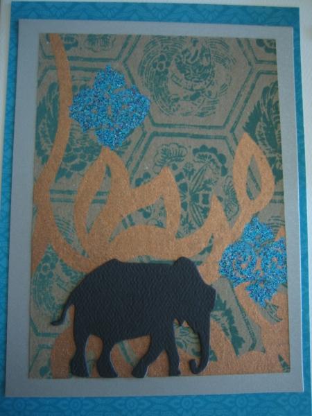 black walking elephant on gold & turquoise