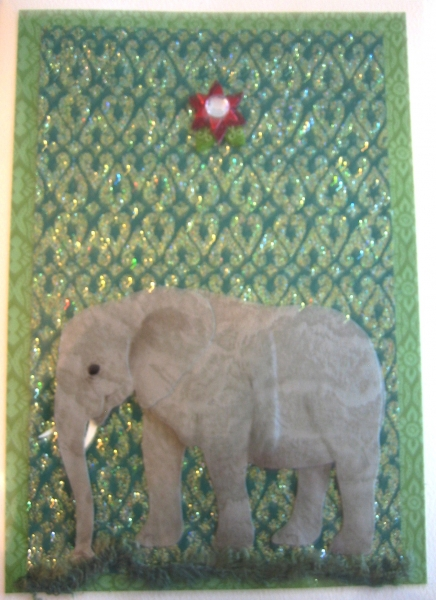 elephant on green glitter with red star