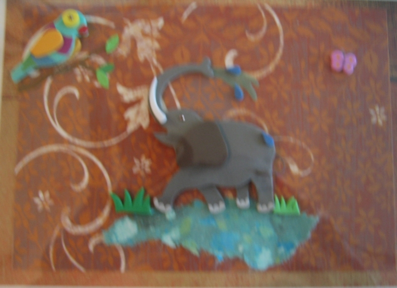 spouting elephant with water and bird