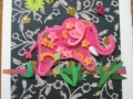 Pink elephant on gold-black