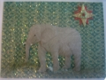 elephant on green glitter with red and gold star